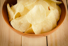 Potato chips on wood stock images
