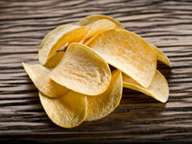 Potato chips on a wood. Royalty Free Stock Photos
