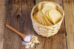 Potato chips in a wooden basket Royalty Free Stock Photography