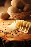 Potato chips on a wooden billet. Royalty Free Stock Images
