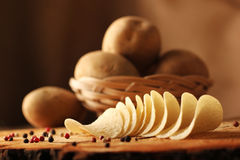 Potato chips on a wooden billet. Royalty Free Stock Photography