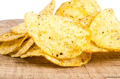 Potato chips. In wooden board Royalty Free Stock Photo
