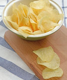 Potato chips in wooden plate Stock Images