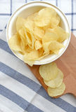 Potato chips in wooden plate Stock Photo