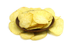 Potato chips in a wooden plate Stock Image
