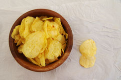 Potato chips in a wooden round plate Stock Photos