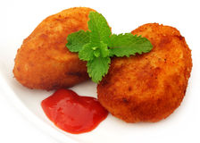 Potato chops with tomato ketchup and fresh mint leaves Royalty Free Stock Photos