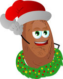 Potato with Christmas wreath and Santa hat Stock Image