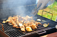 Potato cooking on barbecue grill. Potato cooking outdoors on barbecue grill Royalty Free Stock Images