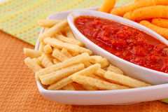 Potato, corn chips and red sauce Royalty Free Stock Photo