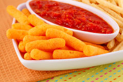 Potato, corn chips and red sauce Royalty Free Stock Image