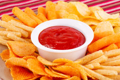 Potato, corn chips and red sauce Stock Image