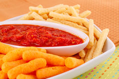 Potato, corn chips and red sauce Royalty Free Stock Photos