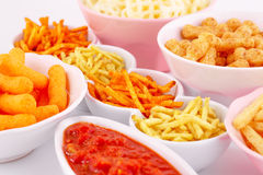Potato, corn and wheat chips in bowls Royalty Free Stock Photo