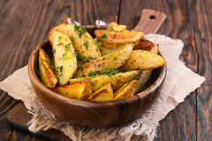 Potato country style with dill. In wooden bowl on wooden background Royalty Free Stock Photo