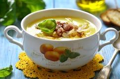 Potato cream soup. Potato cream soup with caramelised onion and smoked bacon stock photo