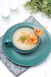 Potato cream soup with glazed shrimp on a skewer Royalty Free Stock Photo