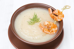 Potato cream soup with glazed shrimps, top view Royalty Free Stock Photos