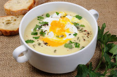 Potato cream soup with poached eggs Royalty Free Stock Image