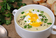 Potato cream soup with poached eggs Stock Photography