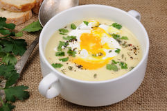 Potato cream soup with poached eggs Royalty Free Stock Photos
