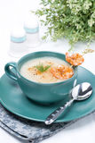 Potato cream soup with shrimps on a skewer Stock Image