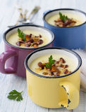 Potato cream soup with wild mushrooms. In the colored cups Royalty Free Stock Photos