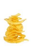 Potato crisps. Stack of potato crisps on white royalty free stock photography