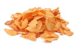 Potato crisps. Heap of potato crisps isolated on white background royalty free stock photos