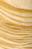 Potato crisps. Pile of natural potato crisps Royalty Free Stock Photo