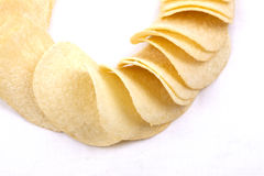 Potato crisps (chips) on a white background Royalty Free Stock Images