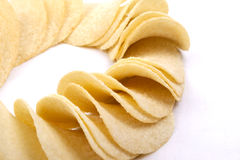Potato crisps (chips) on a white background Royalty Free Stock Photos