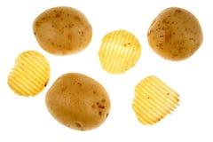 Potato crisps and potatoes Stock Images