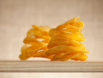 Potato crisps two stacks, focus on the first one Royalty Free Stock Photos