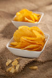 Potato crisps in two white bowls Royalty Free Stock Photos