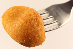 Potato croquette on a fork Stock Images
