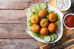 Potato croquette with sauce on a plate top view horizontal Royalty Free Stock Image