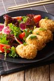 Potato croquettes, or Korokke and fresh vegetables close-up. Ver. Potato croquettes, or Korokke and fresh vegetables close-up on a plate. Vertical Stock Photography