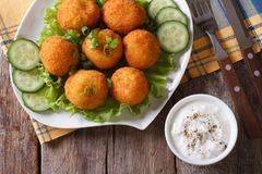 Potato croquettes with lettuce and cucumber top view horizontal Royalty Free Stock Photos