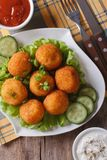 Potato croquettes with lettuce and cucumber top view vertical Stock Photo