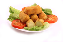 Potato croquettes over vegetables salad Stock Photo