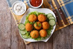 Potato croquettes with sour cream and ketchup top view Royalty Free Stock Photography