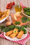 Potato croquettes with spinach and mozzarella. Potato croquettes with spinach and mozzarella on white dish royalty free stock photography