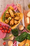 Potato croquettes with spinach and mozzarella. Potato croquettes with spinach and mozzarella on white dish royalty free stock image