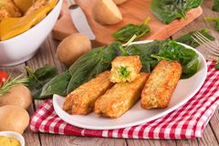Potato croquettes with spinach and mozzarella. stock image