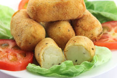 Potato croquettes and tomatoes Stock Images