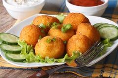 Potato croquettes on a white plate close-up. horizontal Stock Image