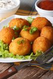 Potato croquettes on a white plate close-up. vertical Royalty Free Stock Images