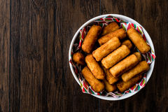 Potato croquettes & x28;croquetas& x29; on wooden surface. Stock Image