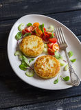 Potato cutlet and fresh tomato and celery salad on a light ceramic plate Stock Photo